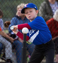 kid hitting t ball