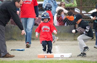 kid running bases t ball